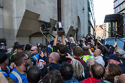 London, UK. 14 May, 2019. Former English Defence League leader Tommy Robinson leaves the Old Bailey following a hearing during which two High Court judges declared that fresh proceedings may be brought against him for an alleged contempt of court over the filming of people involved in a criminal trial.