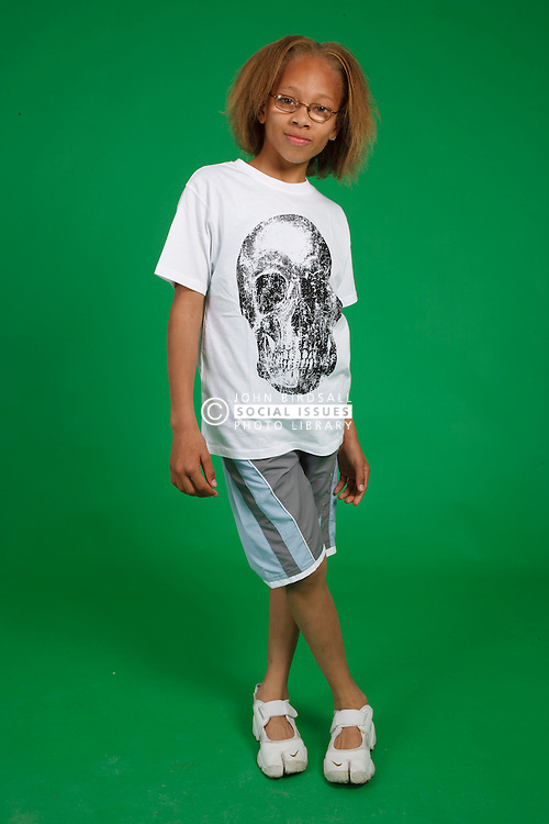 Full length portrait of boy with glasses