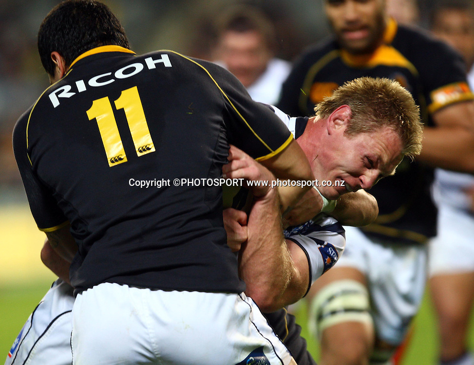 Auckland hooker Tom McCartney is tackled by Hosea Gear.<br />