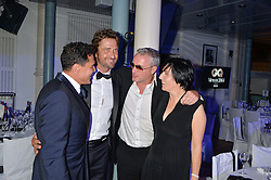 Left to right, ANDRE BALAZS, GERARD BUTLER, EDDIE IRVINE and SHARLEEN SPITERI at the GQ Men Of The Year 2014 Awards in association with Hugo Boss held at The Royal Opera House, London on 2nd September 2014.
