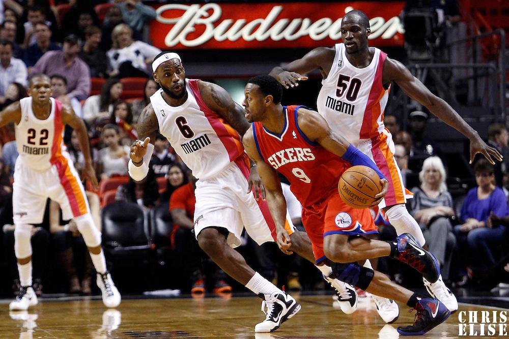 21 January 2012: Miami Heat small forward LeBron James (6) and Miami Heat center Joel Anthony (50) defend on Philadelphia Sixers small forward Andre Iguodala (9) during the Miami Heat 113-92 victory over the Philadelphia Sixers at the AmericanAirlines Arena, Miami, Florida, USA.