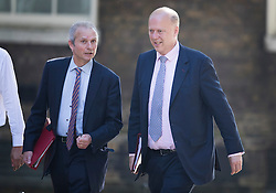 © Licensed to London News Pictures. 19/07/2016. London, UK. David Lidington MP Lord President of the Council, Leader of the House of Commons (L) and Chris Grayling MP<br /> Secretary of State for Transport, arrive in Downing Street for Prime Minister Theresa May's first cabinet.  Photo credit: Peter Macdiarmid/LNP