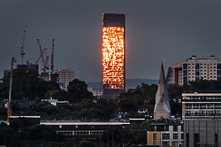 © Licensed to London News Pictures. 05/06/2020. London, UK. Viewed from Primrose Hill a tower block in east London appears to be on fire as its windows reflect the setting sun.  Photo credit: Peter Macdiarmid/LNP