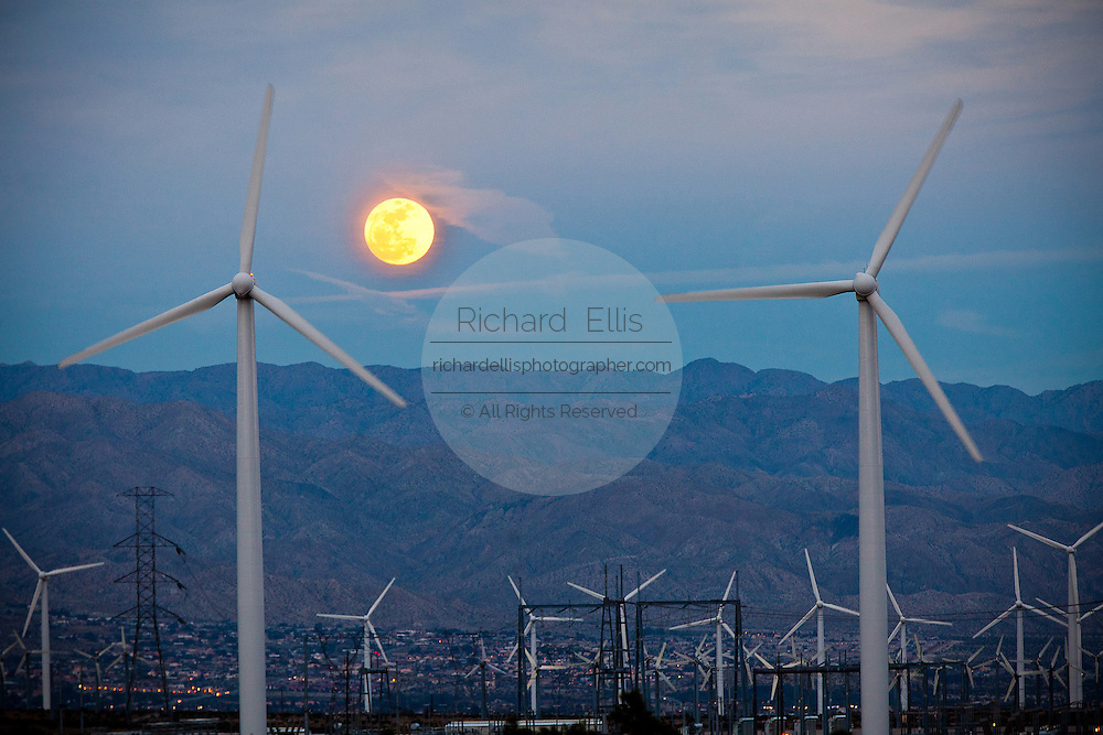 Moon rise over a wind turbine at the San Gorgonio Pass Wind Farm outside Palm Springs, CA.
