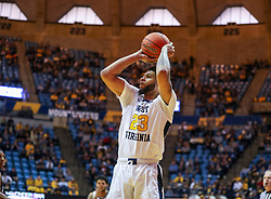 Dec 30, 2018; Morgantown, WV, USA; West Virginia Mountaineers forward Esa Ahmad (23) shoots during the second half against the Lehigh Mountain Hawks at WVU Coliseum. Mandatory Credit: Ben Queen-USA TODAY Sports