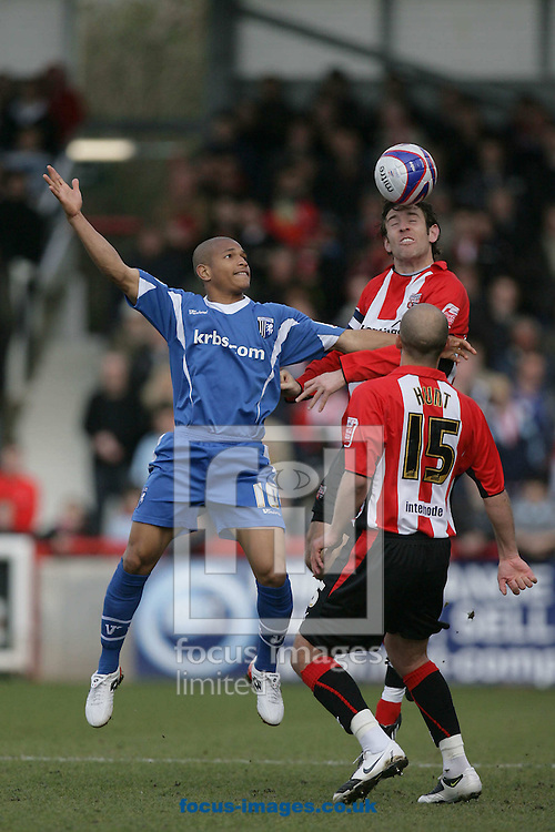 London - Saturday, March 28th, 2009: Alan Bennett of Brentford and Simeon Jackson (L) of Gillingham as Brentford's David Hunt looks on during the Coca Cola League Two match at Griffin Park, London. (Pic by Mark Chapman/Focus Images)