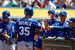 OAKLAND, CA - APRIL 17:  Eric Hosmer #35 of the Kansas City Royals is congratulated by teammates after scoring a run against the Oakland Athletics during the second inning at the Oakland Coliseum on April 17, 2016 in Oakland, California. (Photo by Jason O. Watson/Getty Images) *** Local Caption *** Eric Hosmer