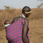 Massai child being carried in the village outside of Amboseli, Kenya.<br />