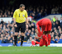 Liverpool's Daniel Agger receives an injury - Photo mandatory by-line: Dougie Allward/JMP - Tel: Mobile: 07966 386802 23/11/2013 - SPORT - Football - Liverpool - Merseyside derby - Goodison Park - Everton v Liverpool - Barclays Premier League