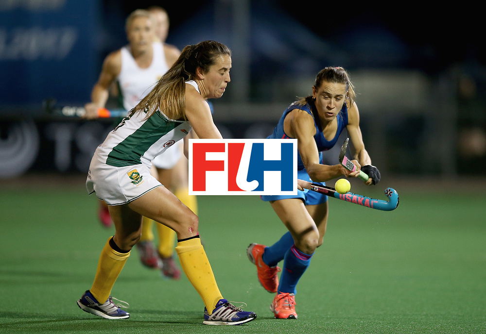 JOHANNESBURG, SOUTH AFRICA - JULY 12: Martina Cavallero of Argentina and Lisa-Marie Deetlefs of South Africa battle for possession during day 3 of the FIH Hockey World League Semi Finals Pool B match between South Africa and Argentina at Wits University on July 12, 2017 in Johannesburg, South Africa. (Photo by Jan Kruger/Getty Images for FIH)