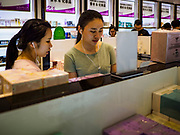 """13 FEBRUARY 2019 - SIHANOUKVILLE, CAMBODIA:  Chinese tourists shop for cosmetics in the Chinese Duty Free Shop (CDF) in Sihanoukville. There are about 80 Chinese casinos and resort hotels open in Sihanoukville and dozens more under construction. The casinos are changing the city, once a sleepy port on Southeast Asia's """"backpacker trail"""" into a booming city. The change is coming with a cost though. Many Cambodian residents of Sihanoukville  have lost their homes to make way for the casinos and the jobs are going to Chinese workers, brought in to build casinos and work in the casinos.      PHOTO BY JACK KURTZ"""