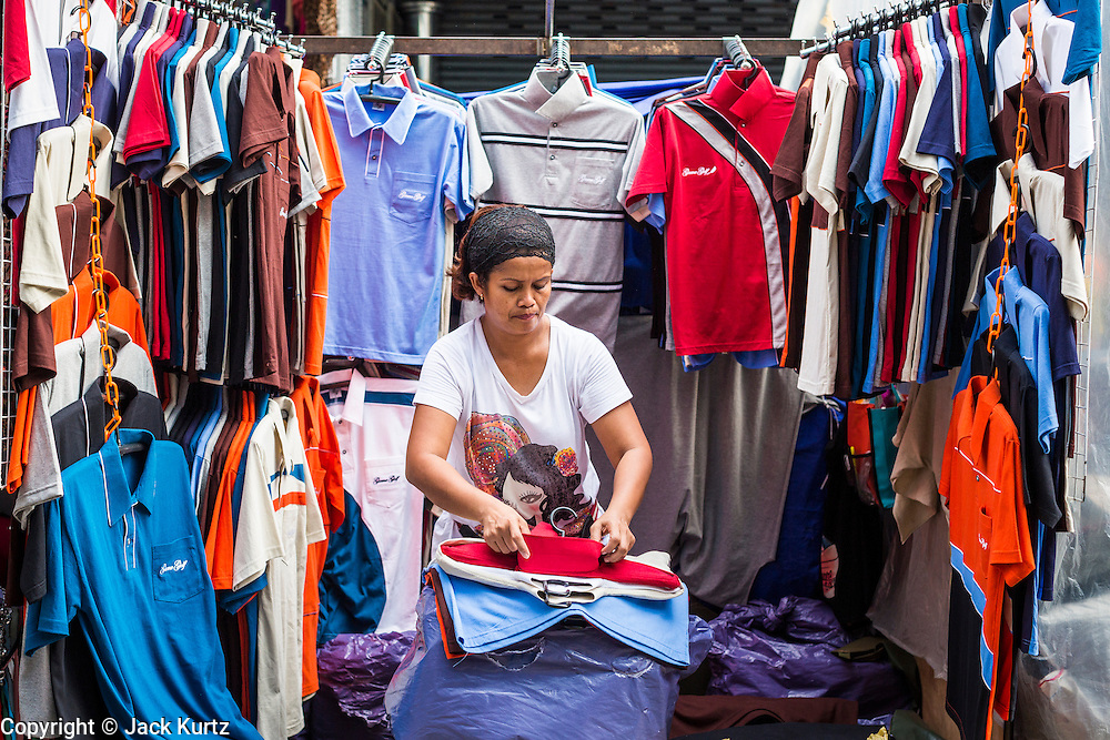 06 JUNE 2013 - BANGKOK, THAILAND:   A vendor sets up her shop in Bobae Market in Bangkok. Bobae Market is a 30 year old market famous for fashion wholesale and is now very popular with exporters from around the world. Bobae Tower is next to the market and  advertises itself as having 1,300 stalls under one roof and claims to be the largest garment wholesale center in Thailand.       PHOTO BY JACK KURTZ