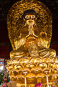Buddha statue inside Wanchun Ting Pavilion on Prospect Hill in Jing Shan Park during summer in Beijing, China