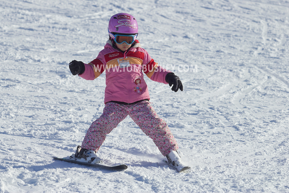Warwick, New York - People ski and snowboard at Mount Peter Ski and Ride on Feb. 10, 2013.