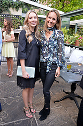 Left to right, SOPHIE CAULCUTT and LAVINIA BRENNAN at a party to celebrate 'A Year In The Garden' celebrating the first year of The Ivy Chelsea Garden, 197 King's Road, London on 16th May 2016.