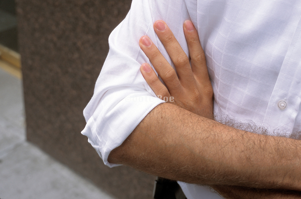 man folding his arms