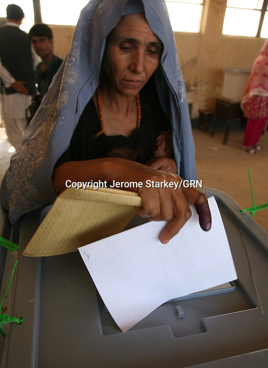 A woman in Lashkar Gah, Helmand, casts her ballot in the Afghan presidential election.