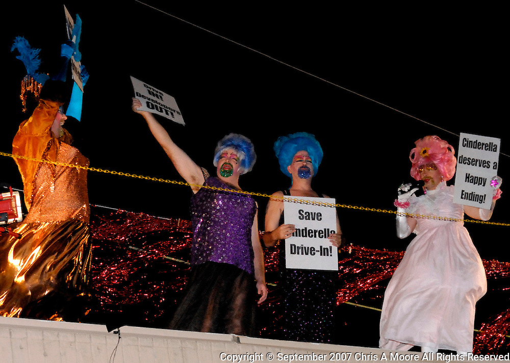 """The Denver-based drag queen troupe known as the Demented Divas is playing fairy godmother and taking the fight to save a local drive-in theater.  The burly belles will perform a version of Cinderella on the roof of the Cinderella Twin Drive-In Movie Theater's concession stand to raise awareness and protest the demolition of south Denver's last drive-in...""""We are doing this protest because Denver hardly needs another set of luxury apartments,"""" says Nuclia Waste, who will be starring as Cinderella. """"It's ridiculous. Drive-in movie theaters are such an American institution, right up there with apple pie, baseball and Mom. They need to be preserved, not torn down.""""..""""We are very sad at the eminent destruction of one of the few remaining drive-in movie theaters in the country,"""" says Jim Goble, manager of the drive-in. """"We are happy that the Demented Divas are just as upset about this and want to stage this protest."""""""