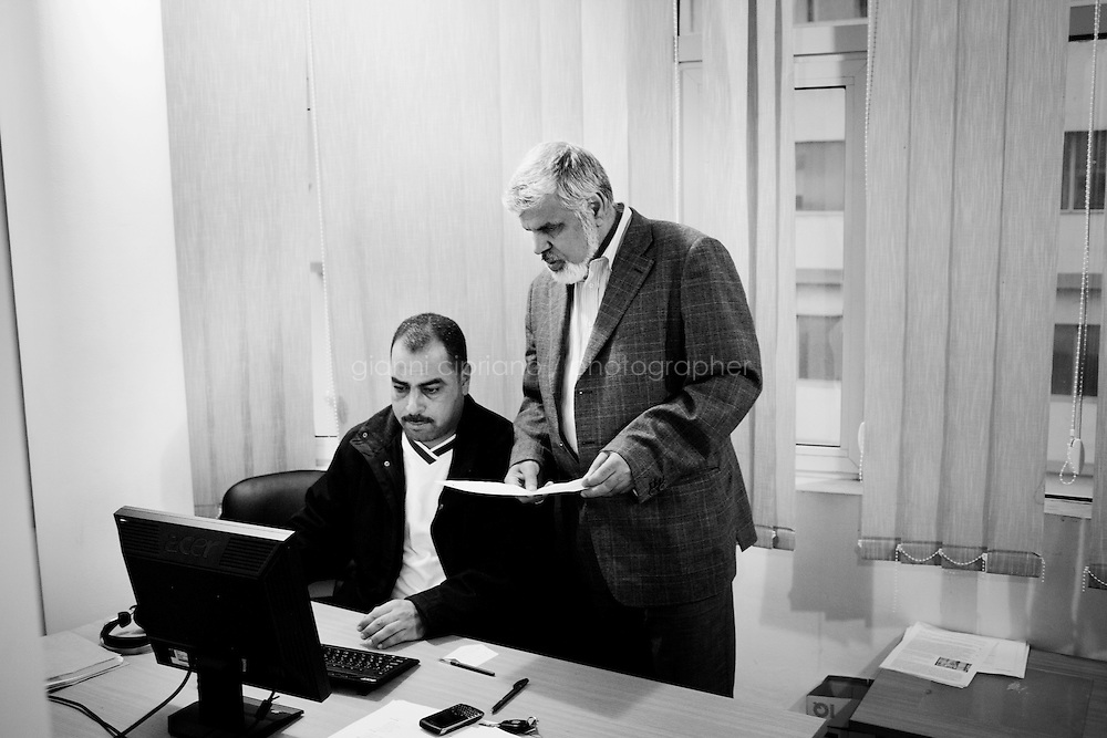 Tunis, Tunisia - 17 December, 2011: Said Ferjani, 57, senior member of the political and communication bureau of the Nahda (Renaissance) party,discusses about a press release with his colleague at the Nahda headquarters in Tunis, Tunisia on 17 December, 2011. In the 24 October 2011 Tunisian Constituent Assembly election, the first elections since the Tunisian Revolution, the party won 40% of the vote, and 89 of the 217 assembly seats, far more than any other party. Said Ferjani started his activism in the Negra mosque of his hometown Kairouan when he was 16 years old, debating on politics, philosophy, economy and world events. In 1989 former dictator Zine El Abidine Ben Ali turned against Nahda (or Ennahda) and jailed 25,000 activists. Said Ferjani was jailed and tortured. He then flew Tunisia and moved to the UK. He came back to Tunisia after 22 years, after former dictator Ben Ali flew the country.<br /> <br /> Gianni Cipriano for The New York Times