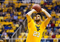 Jan 24, 2017; Morgantown, WV, USA; West Virginia Mountaineers forward Esa Ahmad (23) shoots a foul shot during the second half against the Kansas Jayhawks at WVU Coliseum. Mandatory Credit: Ben Queen-USA TODAY Sports