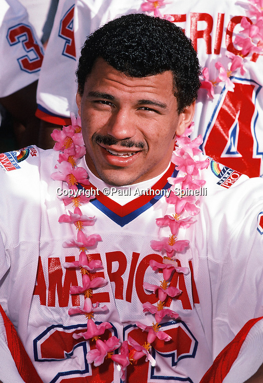 Pittsburgh Steelers defensive back Rod Woodson (26) smiles for a photo with a lei on photo day during the week of the 1990 NFL Pro Bowl between the National Football Conference and the American Football Conference on Jan. 30, 1990 in Honolulu. The NFC won the game 27-21. (©Paul Anthony Spinelli)