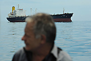 11-10-12 -   LOME, TOGO -  A sailor headed out to the tanker ship Bonito (not pictured) in the Lomé anchorage in Togo, West Africa on October 12, 2011. The threat of piracy in neighbouring Benin has prompted ships to seek safer anchorage in Togolese waters, however many are concerned that pirates will follow the vessels.  Photo by Daniel Hayduk