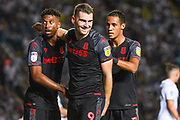 Stoke City forward Sam Vokes (9) scores a goal and celebrates with Stoke City forward Tyrese Campbell (26) and Stoke City midfielder Thomas Ince (7) to make the score 0-2 during the EFL Cup match between Leeds United and Stoke City at Elland Road, Leeds, England on 27 August 2019.
