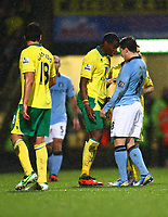 Football - 2012 / 2013 Premier League - Norwich vs. Manchester City<br /> <br /> <br /> Manchester City's Samir Nasri and Norwich City's Sebastien Bassong clash against each other at Carrow Road, Norwich