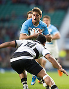 Twickenham, United Kingdom, Puma's Santiago CORDERO, tackled by Lima SOPOAGA, during the Puma's secure  a win against the Baa Baa's in the Killik Cup Match, Barbarians vs Argentina, RFU Stadium, Twickenham, England,<br /> <br /> Saturday    21/11/2015  <br /> <br /> [Mandatory Credit; Peter Spurrier/Intersport-images]