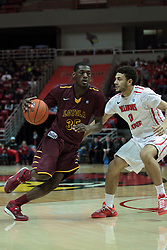 11 January 2014:  Milton Doyle drives in on Kaza Keane during an NCAA  mens basketball game between the Ramblers of Loyola University and the Illinois State Redbirds  in Redbird Arena, Normal IL.  Redbirds win 59-50