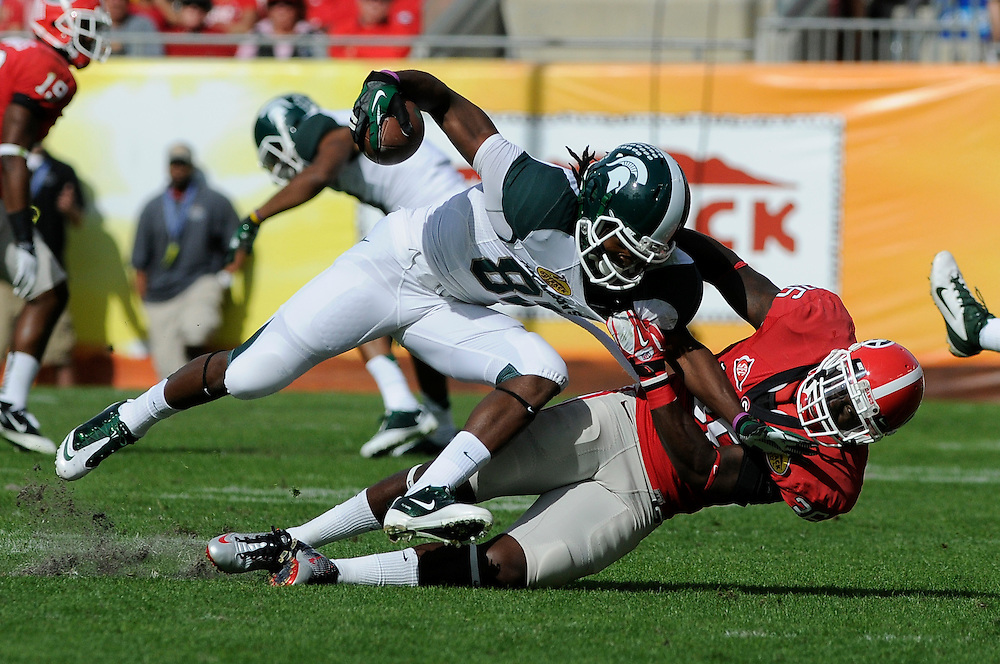 January 2, 2012: Shawn Williams of Georgia tackles Keshawn Martin of Michigan State during the NCAA football game between the Michigan State Spartans and the Georgia Bulldogs at the 2012 Outback Bowl at Raymond James Stadium in Tampa, Florida.