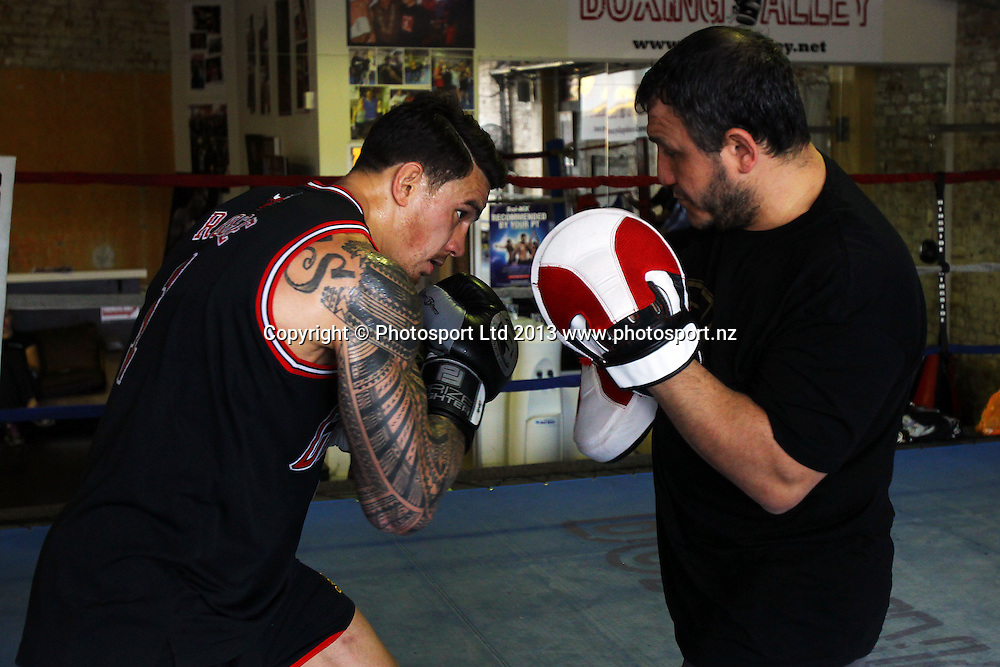 Sonny Bill Williams sparrs with trainer Mahmoud Akkawy during a training session before his upcoming bout. Boxing Alley, Parnell, Auckland. 24 January 2013. Photo: William Booth/photosport.co.nz