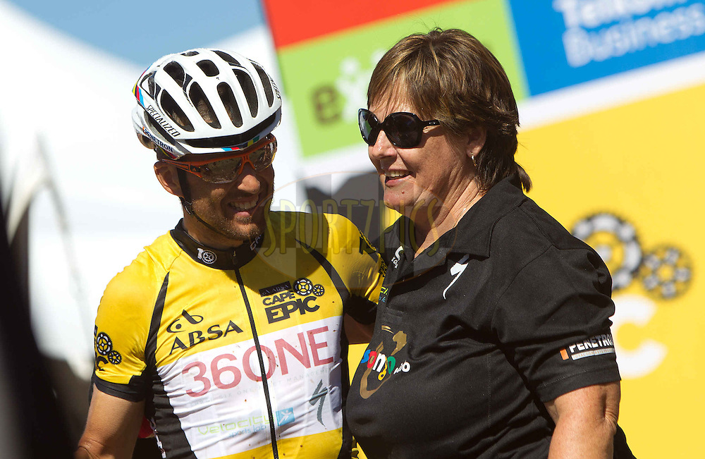 Christoph Sauser of Burry Stander-SONGO with Burry Stander's mother Mandie Stander during the final stage (stage 7) of the 2013 Absa Cape Epic Mountain Bike stage race from Stellenbosch to Lourensford Wine Estate in Somerset West, South Africa on the 24 March 2013..Photo by Karin Schermbrucker/Cape Epic/SPORTZPICS