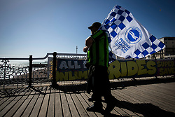 Brighton & Hove Albion fans walk along the pier waving their flags - Mandatory by-line: Jason Brown/JMP - 14/05/17 - FOOTBALL - Brighton and Hove Albion, Sky Bet Championship 2017 - Brighton and Hove Albion Promotion Parade