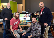 From left, Jesse Bender, Account Manager, Nathan Allebach, Social Media Manager, Christian Betlyon, Digital Strategist, and Joey Piazza, Director of Marketing for Quaker Made Meats sit at a computer monitor with the Twitter account for Steakumm visible on screen at Allebach Communications Tuesday December 19, 2017 in Souderton, Pennsylvania. The Montgomery County marketing firm is trying to have the Steam Twitter account verified with viral success. (WILLIAM THOMAS CAIN / For The Philadelphia Inquirer)