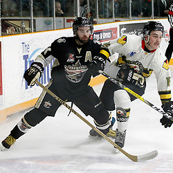 "TRENTON, ON  - MAY 2,  2017: Canadian Junior Hockey League, Central Canadian Jr. ""A"" Championship. The Dudley Hewitt Cup. Game 2 between Trenton Golden Hawks and Powassan Voodoos.  Rhys Brown #16 of the Powassan Voodoos and Nick Boddy #44 of the Trenton Golden Hawks battle for the puck during the first period.<br /> (Photo by Tim Bates / OJHL Images)"