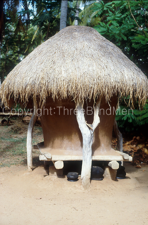 Rice 'Bissa' - mud and wattle storage bins with a thatched roof for storing the rice after harvest.