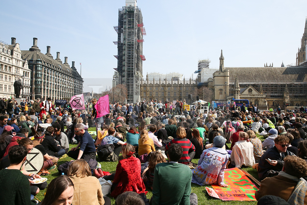 © Licensed to London News Pictures. 15/04/2019. London, UK. Hundreds of Environmental activists demonstrates in Parliament Square to demand decisive action from the UK Government on the environmental crisis by bringing central London to a standstill. Photo credit: Dinendra Haria/LNP