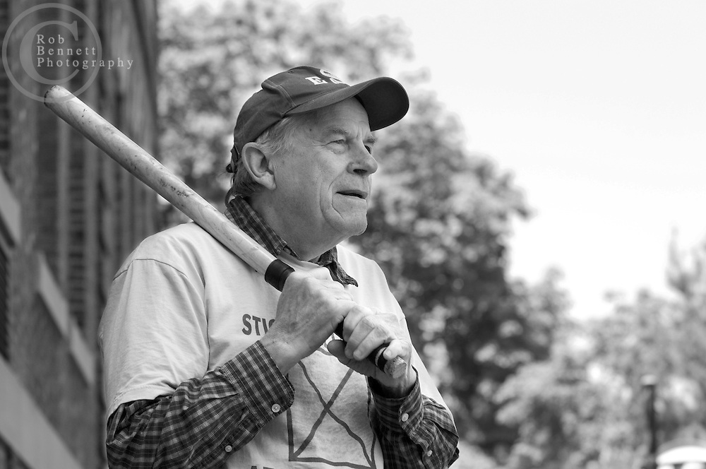 "Kevin ""The Commissioner"" Ettinger, 74 and a retired teacher from Hastings-on-Hudson, prepares to bat during a game of stickball..---.The Ethical Stickball League has been operating since 1970, meeting every Sunday in the parking lot behind Hastings High School from 10:30AM to 1PM.  The players are men now mostly in their 70s - carrying nicknames like ""The Wise One"", ""Hit Man"" and ""Plays Hurt"" - who have an affiliation with the school, either as former teachers, students or neighbors. As their slogan suggests, all it takes for a few hours of ""Aestas Aeterna"" (Eternal Summer) is an outside temperature above 45 degrees and 8 willing souls...CREDIT: Rob Bennett for The NY Times"