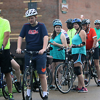 Larry Sword, far left, of Ecru and his daughter Kristen, 4th from the left rode together in the Pedaling for Hope on the TangleFoot Trail in New Albany Saturday to benefit Regional Rehab