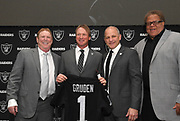 Jan 9, 2018; Alameda, CA, USA; Oakland Raiders owner Mark Davis (left), Jon Gruden (second from left), president Marc Badain (second from left) and general manager Reggie McKenzie pose at a press conference to  introduced Gruden as head coach at a press conference at the Raiders headquarters.