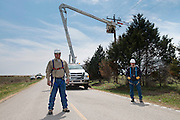 Danny Lemke with Verdigris Valley Co-op works with other electrical lineman to install 3 phase power to a client east of Claremore.  Client Oklahoma Living Magazine.