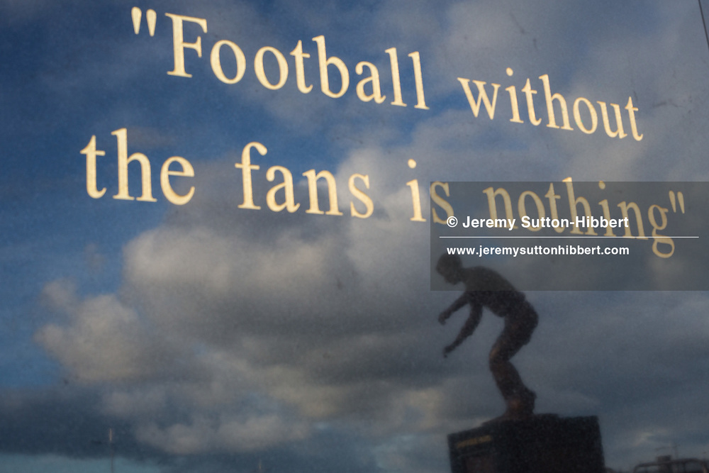 Quote from former manager Jock Stein on a statue's plinth, with reflection of statue of former player and legend Jimmy Johnstone, outside Celtic Park, home of Celtic FC, in Glasgow, Scotland on Friday August 22, 2014.
