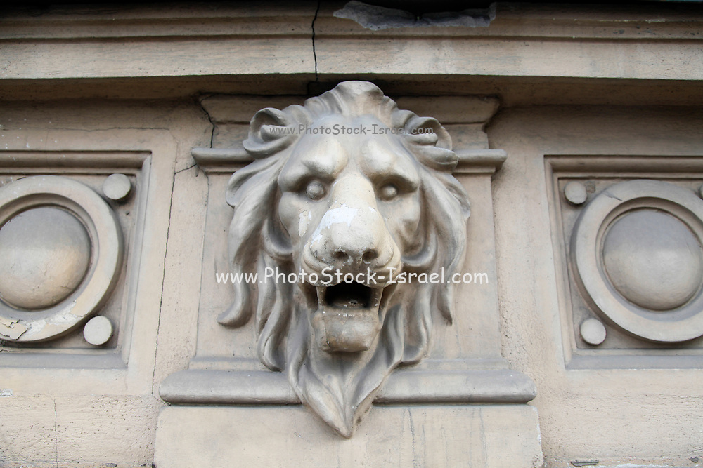 Lionhead on a building in Bucharest, Romania