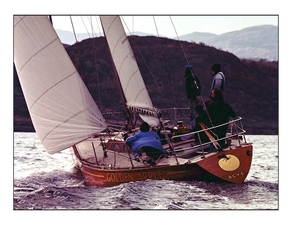 The Clyde Cruising Club's 1977 Tomatin Trophy the first Scottish Series held at Tarbert Loch Fyne.  An overnight race from Gourock to Campbeltown then on to Olympic Triangles in Loch Fyne. ..Golden Apple a Ron Holland 36' One Tonner in cold moulded mahogany.