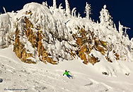 Eleven year old Parkin Costain skis on a sunny day at Whitefish Mountain Resort in Montana model released