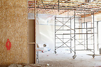 Scaffolding in a empty room at construction site