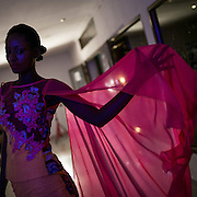 A model wearing a Marcia Creation dress before walking on the runway during the Kinshasa Fashion Week. CAPTA/FEDERICO SCOPPA