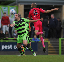 Dover Athletic's Richard Orlu challenges Forest Green Rovers's Jonathan Parkin for the high ball.  - Photo mandatory by-line: Nizaam Jones - Mobile: 07966 386802 - 25/04/2015 - SPORT - Football - Nailsworth - The New Lawn - Forest Green Rovers v Dover - Vanarama Conference League