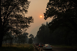 July 19, 2018 - Yosemite National Park, California, U.S - Vistors to Yosemite National Park exit the valley under heavy smoke and haze from the Ferguson Fire on Thursday. (Credit Image: © Tracy Barbutes via ZUMA Wire)